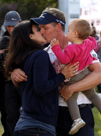 VIRGINIA WATER, ENGLAND - MAY 29:  Luke Donald of England kisses his wife Diane following his victory in a playoff on the 18th green during the final round of the BMW PGA Championship  at the Wentworth Club on May 29, 2011 in Virginia Water, England.  (Photo by Richard Heathcote/Getty Images)