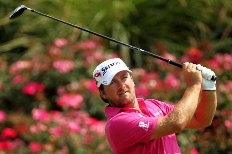 PONTE VEDRA BEACH, FL - MAY 12:  Graeme McDowell of Northern Ireland hits his tee shot on the 18th hole during the first round of THE PLAYERS Championship held at THE PLAYERS Stadium course at TPC Sawgrass on May 12, 2011 in Ponte Vedra Beach, Florida.  (Photo by Mike Ehrmann/Getty Images)