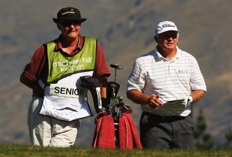 QUEENSTOWN, NEW ZEALAND - MARCH 15:  Peter Senior of Australia (R) looks down towards the 18th green during day four of the New Zealand Men's Open Championship at The Hills Golf Club on March 15, 2009 in Queenstown, New Zealand.  (Photo by Phil Walter/Getty Images)