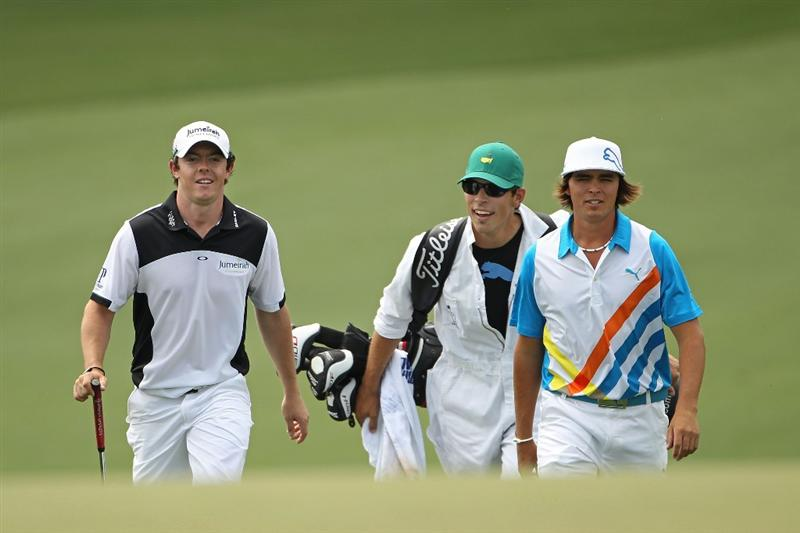 AUGUSTA, GA - APRIL 08:  (L-R) Rory McIlroy of Northern Ireland, Joe Skovron and Rickie Fowler walk together on the ninth hole during the second round of the 2011 Masters Tournament at Augusta National Golf Club on April 8, 2011 in Augusta, Georgia.  (Photo by Jamie Squire/Getty Images)
