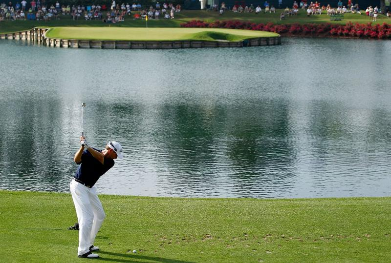 PONTE VEDRA BEACH, FL - MAY 06:  Davis Love III  plays his tee shot on the 17th hole during the first round of THE PLAYERS Championship held at THE PLAYERS Stadium course at TPC Sawgrass on May 6, 2010 in Ponte Vedra Beach, Florida.  (Photo by Scott Halleran/Getty Images)