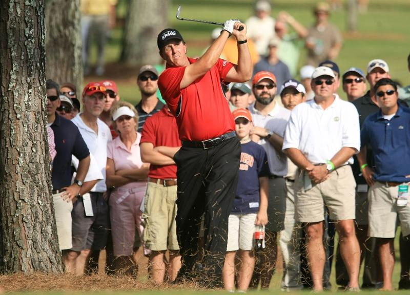 ATLANTA - SEPTEMBER 25:  Phil Mickelson plays a shot right-handed from the rough on the 16th hole during the first round of THE TOUR Championship at East Lake Golf Club on September 25, 2008 in Atlanta, Georgia.  (Photo by Scott Halleran/Getty Images)