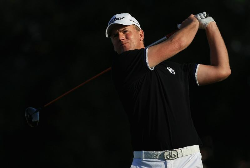 DOHA, QATAR - FEBRUARY 04:  Robert Karlsson of Sweden hits his tee-shot on the 18th hole during the second round of the Commercialbank Qatar Masters held at Doha Golf Club on February 4, 2011 in Doha, Qatar.  (Photo by Andrew Redington/Getty Images)