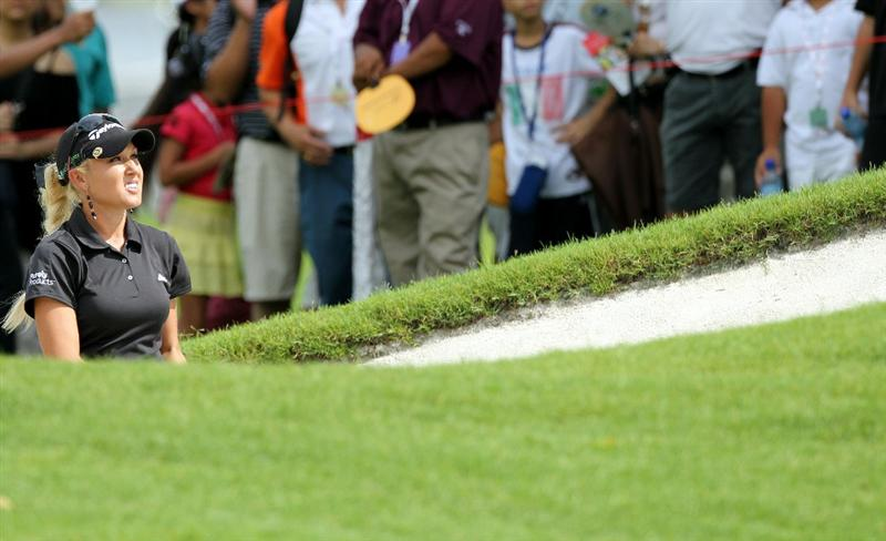KUALA LUMPUR, MALAYSIA - OCTOBER 24:  Natalie Gulbis of USA watching her tee shot on the 1st hole during the Final Round of the Sime Darby LPGA on October 24, 2010 at the Kuala Lumpur Golf and Country Club in Kuala Lumpur, Malaysia. (Photo by Stanley Chou/Getty Images)