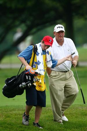 OAKVILLE, ONTARIO - JULY 25:  Mark Calcavecchia is handed his putter by son Eric Calcavecchia as they walk to the ninth green during round two of the RBC Canadian Open at Glen Abbey Golf Club on July 25, 2009 in Oakville, Ontario, Canada.  (Photo by Chris McGrath/Getty Images)