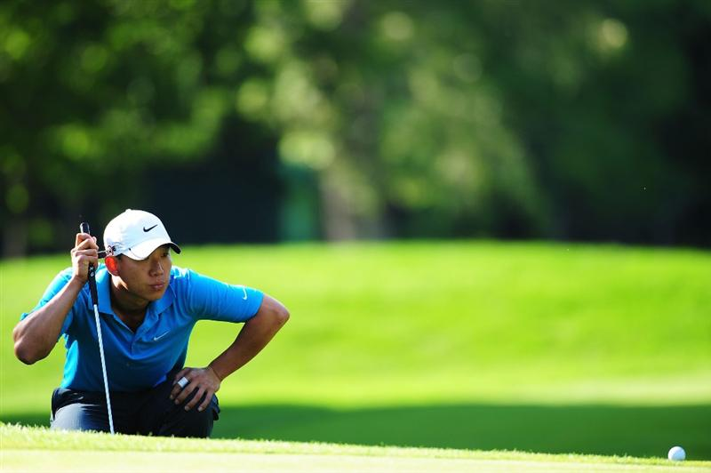 CHASKA, MN - AUGUST 14:  Anthony Kim lines up a putt on the 11th green during the second round of the 91st PGA Championship at Hazeltine National Golf Club on August 14, 2009 in Chaska, Minnesota.  (Photo by Stuart Franklin/Getty Images)