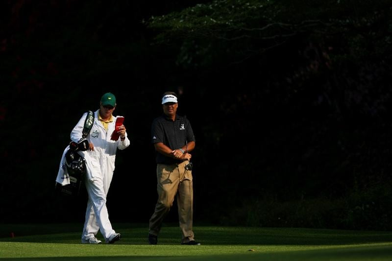 AUGUSTA, GA - APRIL 11:  Kenny Perry walks with his caddie Fred Sanders on the 13th hole during the third round of the 2009 Masters Tournament at Augusta National Golf Club on April 11, 2009 in Augusta, Georgia.  (Photo by Andrew Redington/Getty Images)