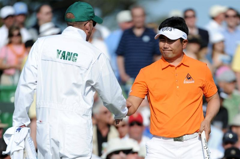 AUGUSTA, GA - APRIL 07:  Y.E. Yang of South Korea shakes hands with his caddie Michael Bestor after finishing on the 18th hole during the first round of the 2011 Masters Tournament at Augusta National Golf Club on April 7, 2011 in Augusta, Georgia.  (Photo by Harry How/Getty Images)