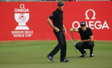 SHENZHEN, CHINA - NOVEMBER 22:  Raphael Jacquelin and Gregory Havret of France during the first round of the Omega Mission Hills World Cup at the Mission Hills Golf Resort on November 22, 2007 in Shenzhen, China.  (Photo by Stuart Franklin/Getty Images)