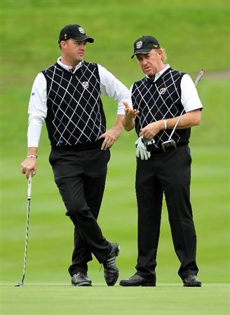 NEWPORT, WALES - OCTOBER 02:  Peter Hanson of Europe talks with Miguel Angel Jimenez (R) during the rescheduled Afternoon Foursome Matches during the 2010 Ryder Cup at the Celtic Manor Resort on October 2, 2010 in Newport, Wales.  (Photo by Jamie Squire/Getty Images)