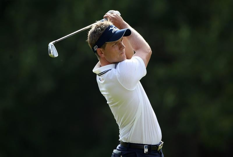 VIRGINIA WATER, ENGLAND - MAY 29:  Luke Donald of England hits an approach shot during the final round of the BMW PGA Championship  at the Wentworth Club on May 29, 2011 in Virginia Water, England.  (Photo by Warren Little/Getty Images)