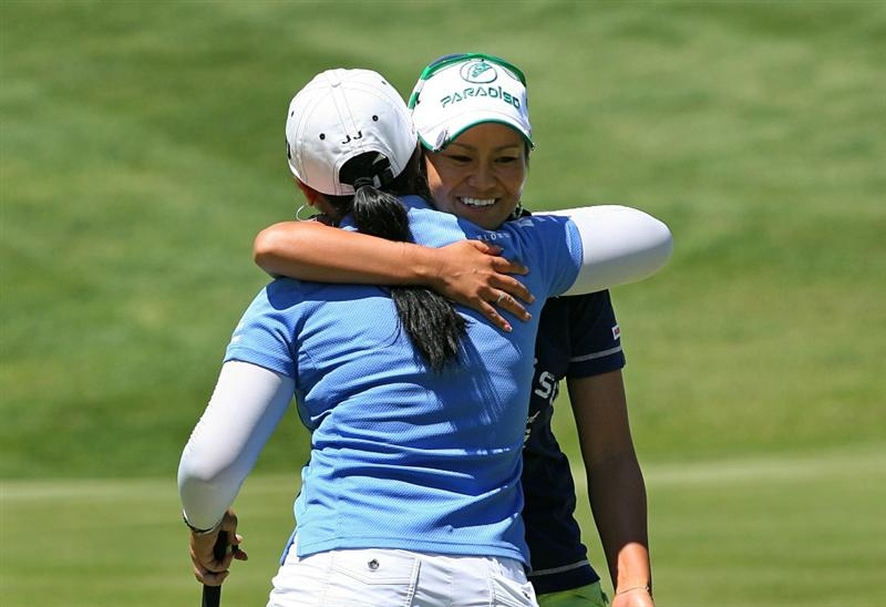GLADSTONE, NJ - MAY 20 : Ai Miyazato of Japan hugs Jeong Jang of South Korea after finishing their match on the 15th hole during the first round of the Sybase Match Play Championship at Hamilton Farm Golf Club on May 20, 2010 in Gladstone, New Jersey. (Photo by Hunter Martin/Getty Images)
