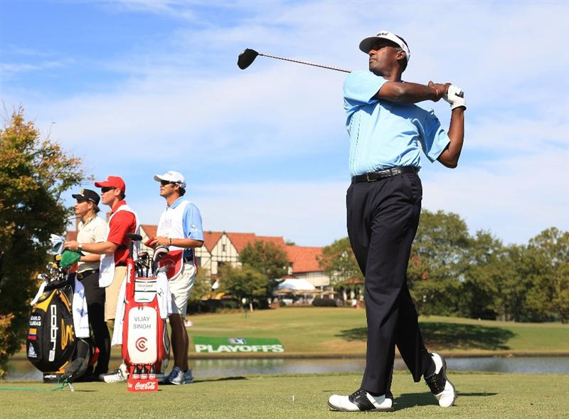 ATLANTA - SEPTEMBER 25:  Vijay Singh of Fiji plays his tee shot on the seventh hole during the first round of THE TOUR Championship at East Lake Golf Club on September 25, 2008 in Atlanta, Georgia.  (Photo by Scott Halleran/Getty Images)