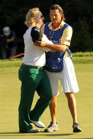 NORTON, MA - SEPTEMBER 06:  Charley Hoffman reacts with caddie Miguel Rivera on the 18th hole during the final round of the Deutsche Bank Championship at TPC Boston on September 6, 2010 in Norton, Massachusetts.  (Photo by Mike Ehrmann/Getty Images)