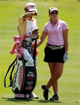 AVENTURA, FL - APRIL 27:  Paula Creamer (R) and her caddie Colin Cann discuss what club to use in the fairway on the 11th hole during the final round of the Stanford International Pro-Am at Fairmont Turnberry Isle Resort & Club April 27, 2008 in Aventura, Florida. Annika Sorenstam defeated Creamer in a one hole playoff.  (Photo by Doug Benc/Getty Images)