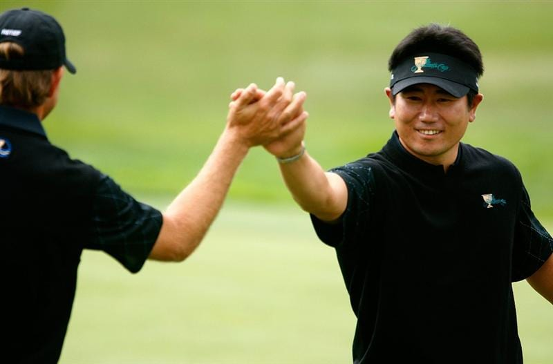 SAN FRANCISCO - OCTOBER 08:  Y.E. Yang of the International Team celebrates with playing partner Retief Goosen after holing a putt on the first green during the Day One Foursome Matches of The Presidents Cup at Harding Park Golf Course on October 8, 2009 in San Francisco, California.  (Photo by Scott Halleran/Getty Images)