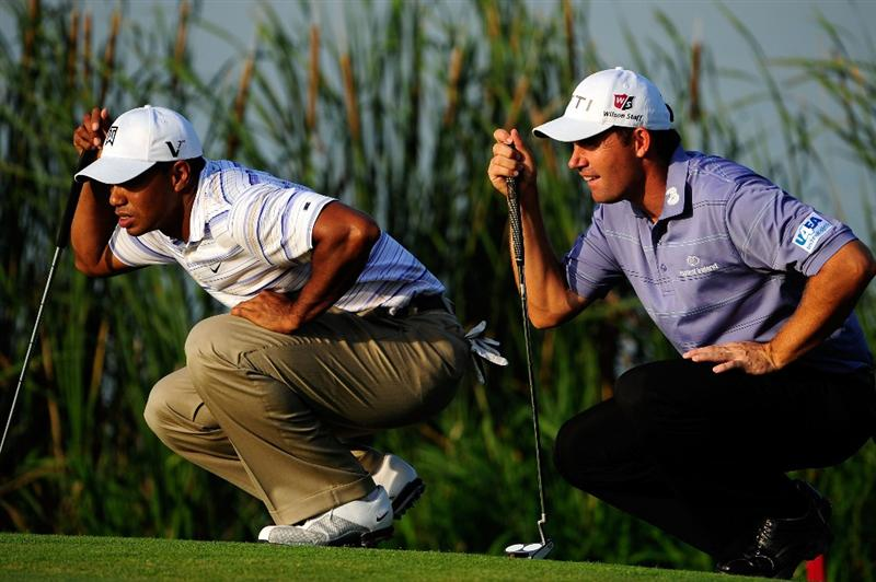 CHASKA, MN - AUGUST 14:  (L-R) Tiger Woods and Padraig Harrington of Ireland line up their putts on the 16th hole during the second round of the 91st PGA Championship at Hazeltine National Golf Club on August 14, 2009 in Chaska, Minnesota.  (Photo by Sam Greenwood/Getty Images)
