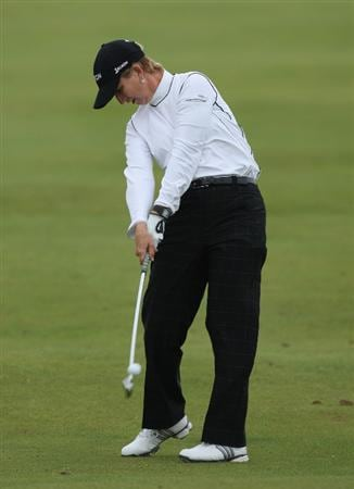 LYTHAM ST ANNES, ENGLAND - AUGUST 01:  Karrie Webb of Australia hits her second shot on the 2nd hole during the third round of the 2009 Ricoh Women's British Open Championship held at Royal Lytham St Annes Golf Club, on August 1, 2009 in Lytham St Annes, England.  (Photo by David Cannon/Getty Images)