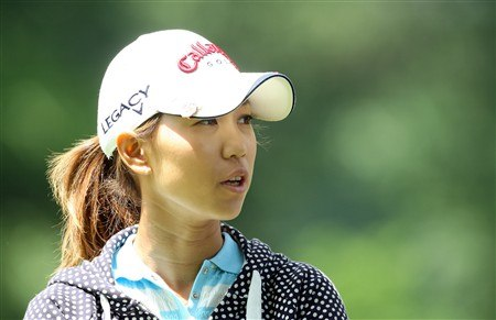 EDINA, MN - JUNE 28:  Momoko Ueda of Japan waits to hit her second shot at the 3rd hole during the third round of the 2008 U.S. Women's Open Championship held at Interlachen Country Club on June 28, 2008 in Edina, Minnesota.  (Photo by David Cannon/Getty Images)