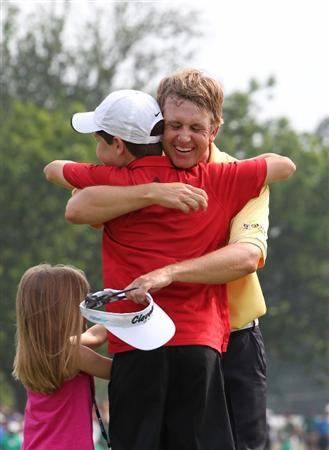 FORT WORTH, TX - MAY 22: David Toms hugs his son Carter on the 18th green after winning the Crowne Plaza Invitational at Colonial Country Club on May 22, 2011 in Fort Worth, Texas. (Photo by Hunter Martin/Getty Images)