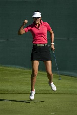 ROGERS, AR - SEPTEMBER 12:  Michelle Wie celebrates a birdie putt on the 17th hole during the final round of the P&G NW Arkansas Championship at the Pinnacle Country Club on September 12, 2010 in Rogers, Arkansas.  (Photo by Robert Laberge/Getty Images)