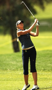 Jill McGill follows the flight of her shot from the 11th fairway during the first round of the LPGA's 2005 Kraft Nabisco Championship, at Mission Hills Country Club in Rancho Mirage, California March 24, 2005.