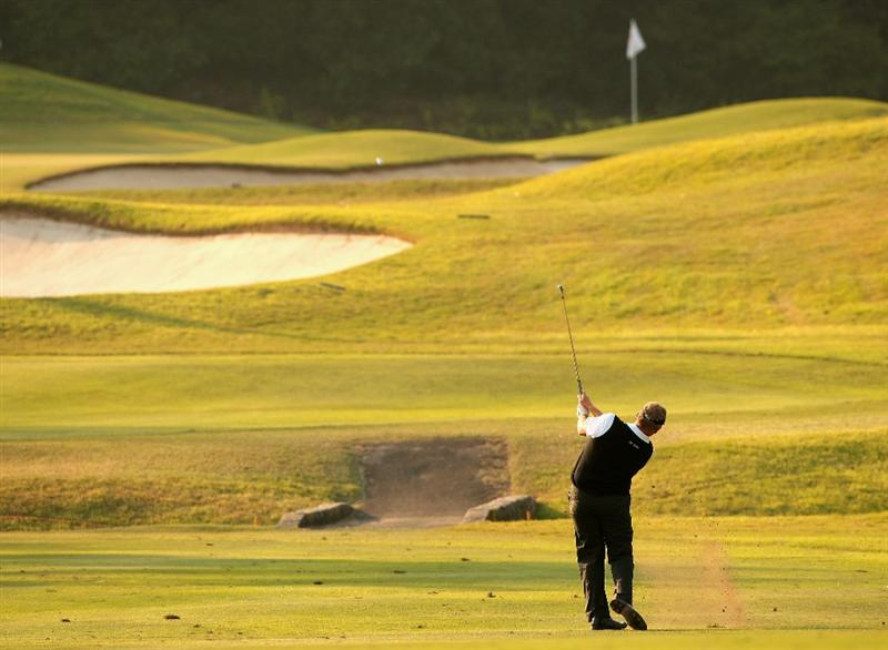 HONG KONG, CHINA - NOVEMBER 20:  Colin Montgomerie of Scotland plays his approach shot on the 17th hole during the first round of the UBS Hong Kong Open at the Hong Kong Golf Club on November 20, 2008 in Fanling, Hong Kong.  (Photo by Stuart Franklin/Getty Images)