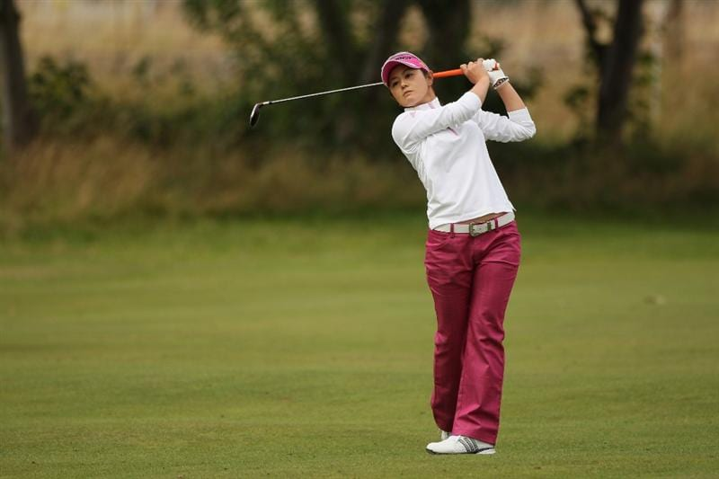 LYTHAM ST ANNES, ENGLAND - AUGUST 01:  Shinobu Moromizato of Japan hits an approach shot during the third round of the 2009 Ricoh Women's British Open Championship held at Royal Lytham St Annes Golf Club, on August 1, 2009 in Lytham St Annes, England.  (Photo by Warren Little/Getty Images)