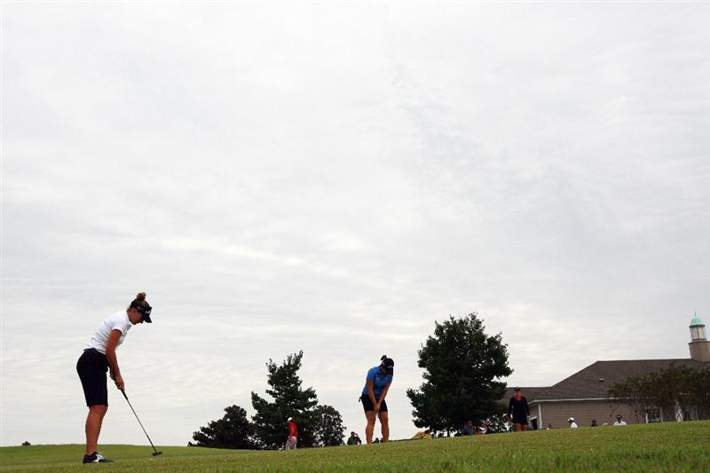 PRATTVILLE, AL - OCTOBER 4:  Brittany Lang, left, prepares for her final round play in the Navistar LPGA Classic at the Robert Trent Jones Golf Trail at Capitol Hill on October 4, 2009 in  Prattville, Alabama.  (Photo by Dave Martin/Getty Images)