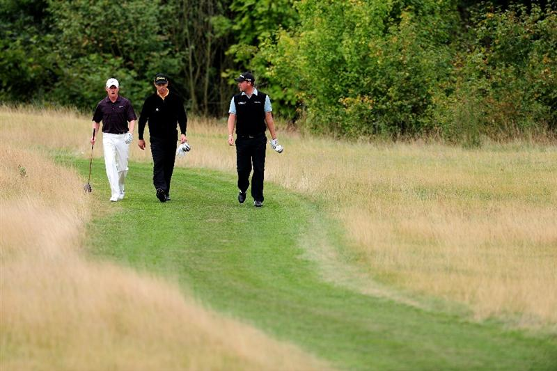 COLOGNE, GERMANY - SEPTEMBER 13: Simon Dyson of England Soren Hansen of Denmark and Peter Hanson of Sweden during the final round of The Mercedes-Benz Championship at The Gut Larchenhof Golf Club on September 13, 2009 in Cologne, Germany.  (Photo by Stuart Franklin/Getty Images)