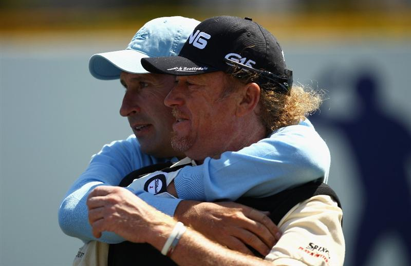 VIRGINIA WATER, ENGLAND - MAY 23:  Jose Maria Olazabal and Miguel Angel Jimenez of Spain embrace before the 'Ole Seve' Pro-Am in aid of the Seve Ballesteros Foundation at Wentworth Club on May 23, 2011 in Virginia Water, England.  (Photo by Richard Heathcote/Getty Images)