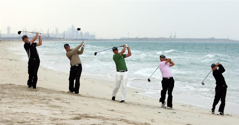 ABU DHABI, UNITED ARAB EMIRATES - JANUARY 13:  (L-R) Padraig Harrington of Ireland, Paul Casey of England, Henrik Stenson of Sweden, Robert Allenby of Australia and Sergio Garcia of Spain hit a shot off of the beach during a photo call on the Saadiyat Island prior to the Abu Dhabi Golf Championship at the Abu Dhabi Golf Club on January 13, 2009 in Abu Dhabi, United Arab Emirates.  (Photo by Ross Kinnaird/Getty Images)