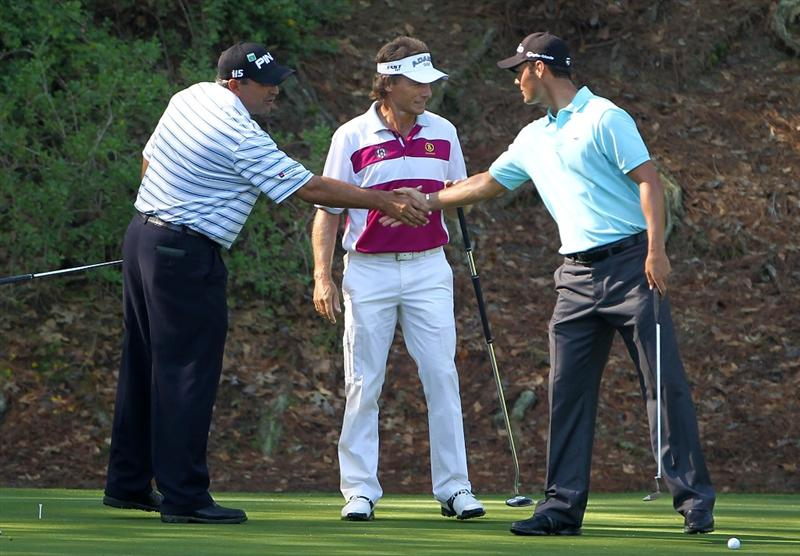 AUGUSTA, GA - APRIL 06:  Angel Cabrera of Argentina (L) shakes hands with Martin Kaymer of Germany (R) while Bernhard Langer of Germany (C) looks on during a practice round prior to the 2010 Masters Tournament at Augusta National Golf Club on April 6, 2010 in Augusta, Georgia.  (Photo by Jamie Squire/Getty Images)