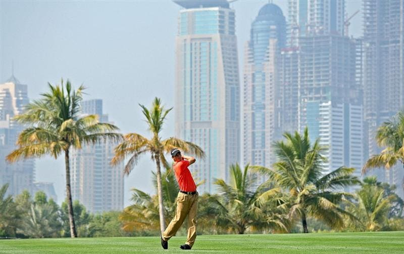 DUBAI, UNITED ARAB EMIRATES - JANUARY 29:  Martin Kaymer of Germany hits his second shot at the par 5, 13th hole during the first round of the 2009 Dubai Desert Classic on the Majilis Course at the Emirates Golf Club on January 29, 2009 in Dubai, United Arab Emirates  (Photo by David Cannon/Getty Images)