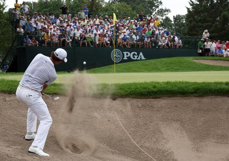 CHASKA, MN - AUGUST 13:  Adam Scott of Australia plays a bunker shot on the fourth hole during the first round of the 91st PGA Championship at Hazeltine National Golf Club on August 13, 2009 in Chaska, Minnesota.  (Photo by David Cannon/Getty Images)