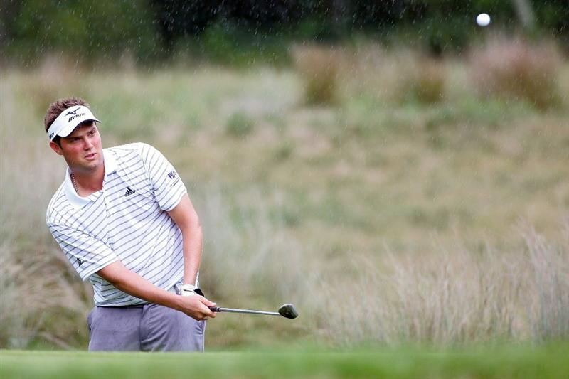 NORTON, MA - SEPTEMBER 03:  Jeff Overton hits a shot on the fourth hole during the first round of the Deutsche Bank Championship at TPC Boston on September 3, 2010 in Norton, Massachusetts.  (Photo by Michael Cohen/Getty Images)