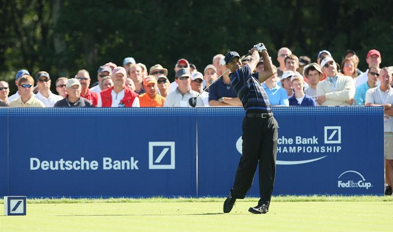 NORTON, MA - SEPTEMBER 4:  Tiger Woods hits a tee shot during Round One of the 2009 Deutsche Bank Championship In Norton, Massachusetts on September 5, 2009 in Boston, Massachusetts. (Photo by Jim Rogash/Getty Images)