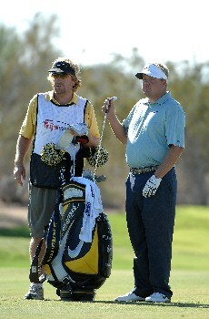 SCOTTSDALE, AZ - OCTOBER 20:  Carl Pettersson pulls a club for his approach shot into the 10th hole during the third round of the Fry's Electronics Open on October 20, 2007 at the Grayhawk Golf Club in Scottsdale, Arizona  (Photo by Marc Feldman/Getty Images)