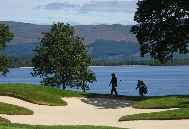 LUSS, UNITED KINGDOM - JULY 10:  Adam Scott of Australia and his caddy walk on the 6th hole during the Second Round of The Barclays Scottish Open at Loch Lomond Golf Club on July 10, 2009 in Luss, Scotland. (Photo by Andrew Redington/Getty Images)