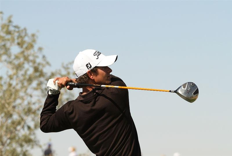 MARANA, AZ - FEBRUARY 18:  Adam Scott of Australia tees off on the eighth hole during round two of the Accenture Match Play Championship at the Ritz-Carlton Golf Club on February 18, 2010 in Marana, Arizona.  (Photo by Darren Carroll/Getty Images)