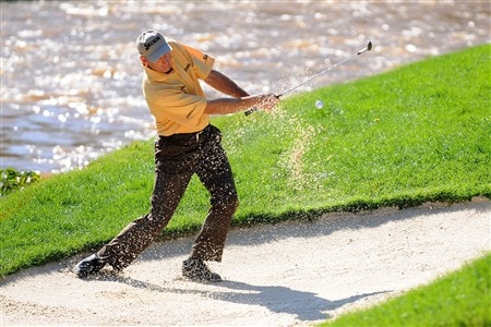 OAKVILLE, ON - JULY 25:  Jim Furyk makes a shot out of a bunker on the 13th hole as he resumes his first round that was delayed by rainstorms yesterday at the RBC Canadian Open at the Glen Abbey Golf Club on July 25, 2008 in Oakville, Ontario.   (Photo by Robert Laberge/Getty Images)