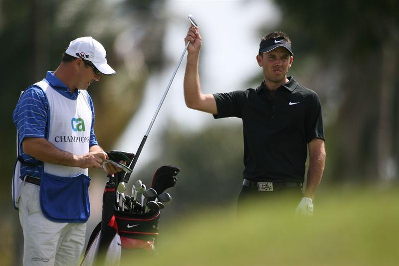 DORAL, FL - MARCH 14:  Charl Schwartzel of South Africa pulls a club out of his bag on the second hole during the final round of the 2010 WGC-CA Championship at the TPC Blue Monster at Doral on March 14, 2010 in Doral, Florida.  (Photo by Marc Serota/Getty Images)