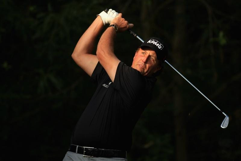 CHARLOTTE, NC - MAY 06:  Phil Mickelson watches his tee shot on the 12th hole during the second round of the Wells Fargo Championship at Quail Hollow Club on May 6, 2011 in Charlotte, North Carolina.  (Photo by Streeter Lecka/Getty Images)