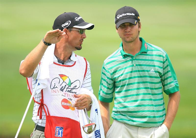 ORLANDO, FL - MARCH 27:  Sean O'Hair chats with his caddie Paul Tesori on the 13th green during the second round of the Arnold Palmer Invitational at the Bay Hill Club & Lodge on March 27, 2009 in Orlando, Florida.  (Photo by Scott Halleran/Getty Images)