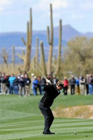 MARANA, AZ - FEBRUARY 27:  Luke Donald of England hits an approach shot on the first hole during the final round of the Accenture Match Play Championship at the Ritz-Carlton Golf Club on February 27, 2011 in Marana, Arizona.  (Photo by Stuart Franklin/Getty Images)