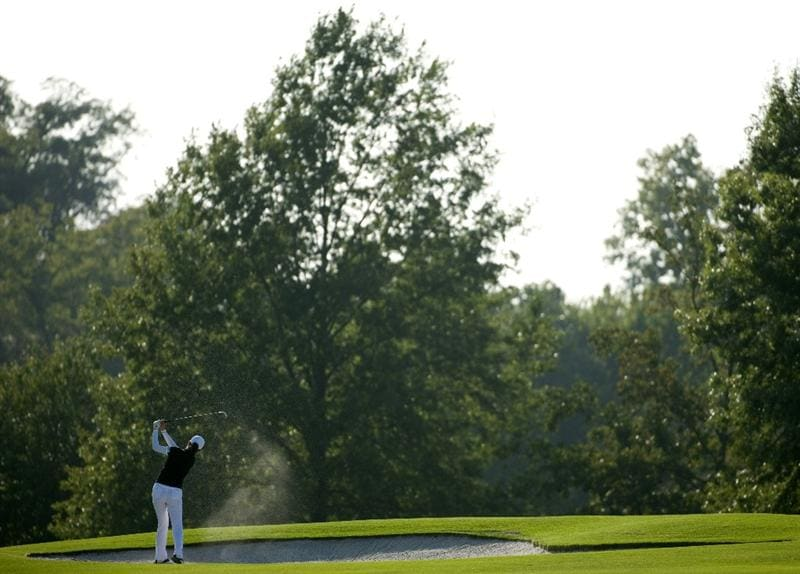 ROGERS, AR - SEPTEMBER 10:  Shi Hyun Ahn of South Korea makes a shot out of a bunker on the 18th hole during the first round of the P&G NW Arkansas Championship at the Pinnacle Country Club on September 10, 2010 in Rogers, Arkansas.  (Photo by Robert Laberge/Getty Images)