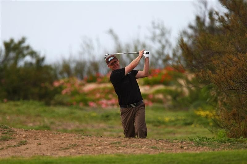 MADEIRA, PORTUGAL - MARCH 20:  Joakim Haeggman of Sweden plays out of the rough on the sixteenth fairway during round two of the Madeira Islands Open BPI at the Porto Santo Golfe Club on March 20, 2009 in Porto Santo,Portugal.  (Photo by Michael Steele/Getty Images)