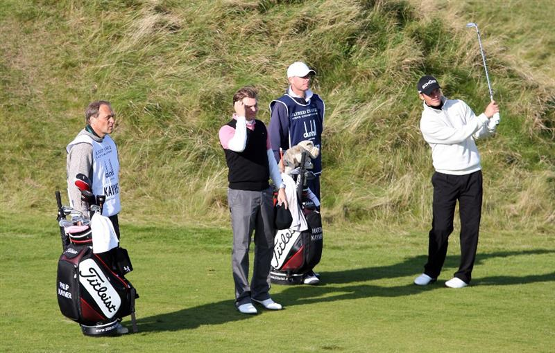 KINGSBARNS, UNITED KINGDOM - OCTOBER 02:  Martin Kaymer of Germany plays his second shot to the seventh hole watched by his father Horst Kaymer and brother Philip Kaymer during the first round of The Alfred Dunhill Links Championship at Kingsbarns Golf Links on October 2, 2008 in Kingbarns, Scotland.  (Photo by Ross Kinnaird/Getty Images)