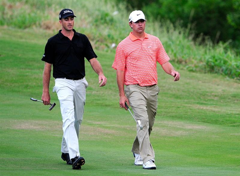 KAPALUA, HI - JANUARY 10:  Geoff Ogilvy of Australia (L) and Lucas Glover walk down the 18th hole during the final round of the SBS Championship at the Plantation course on January 10, 2010 in Kapalua, Maui, Hawaii.  (Photo by Sam Greenwood/Getty Images)