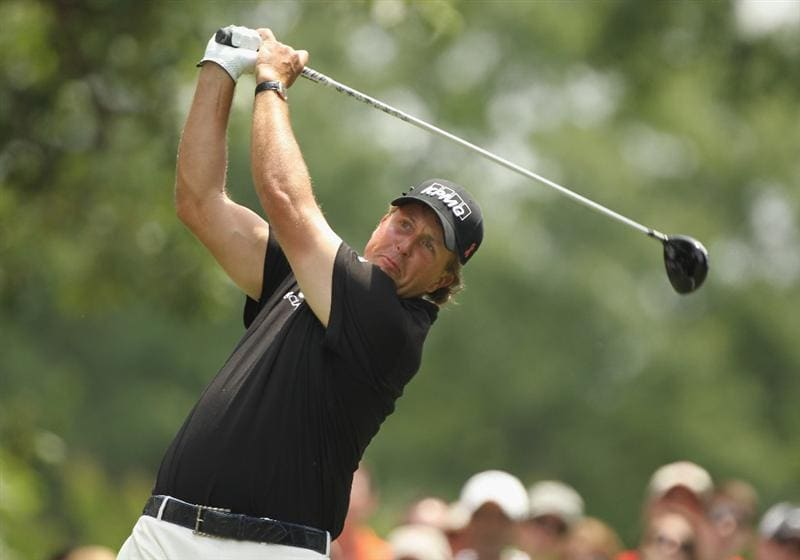 CHARLOTTE, NC - MAY 08:  Phil Mickelson watches his tee his shot on the fourth hole during the final round of the Wells Fargo Championship at the Quail Hollow Club on May 8, 2011 in Charlotte, North Carolina.  (Photo by Scott Halleran/Getty Images)